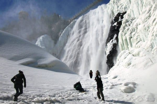 people at the fozen Montmorency Falls in Quebec