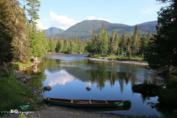 canoe in the river in the forest at gaspesie