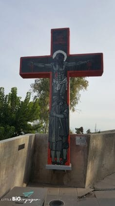 giant cross with pictures at park cerro San Cristobal