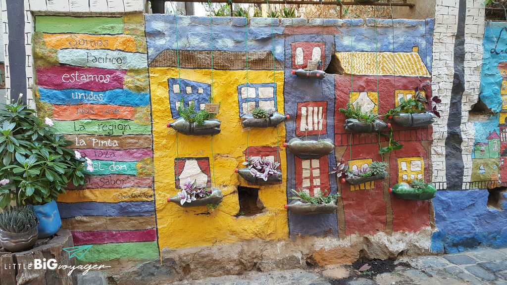 street art Valapraiso - recycled bottles included in a wall painting