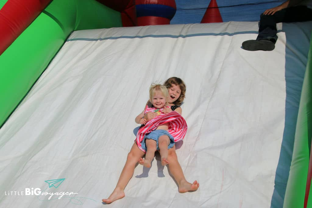 Big and Little J at a bouncy castle